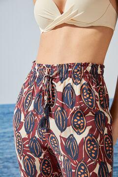 Womensecret Длинные струящиеся брюки с тропическим принтом бежевый